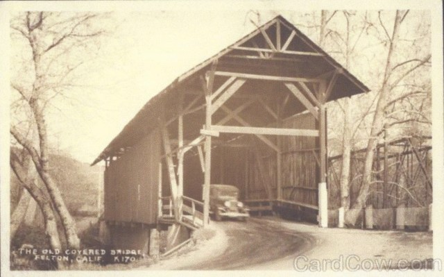 Auto crossing Covered Bridge. Railroad bridge at right. 1920's.
