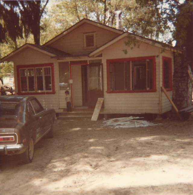 1982 shortly after the big flood. My first house, 258 Circle Dr, Felton Grove. My son Eli on step, age 4.